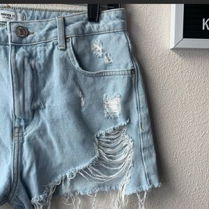 High waisted super distressed denim shorts